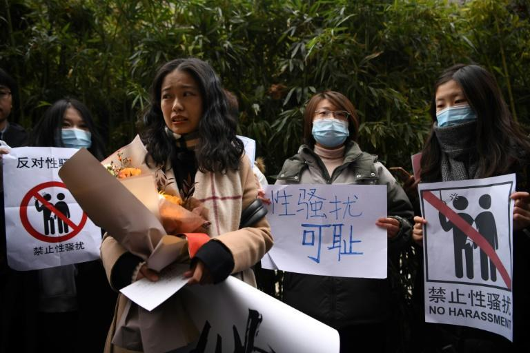 Zhou Xiaoxuan (front) rose to prominence during China's #MeToo movement two years ago after accusing an influential broadcaster of assault