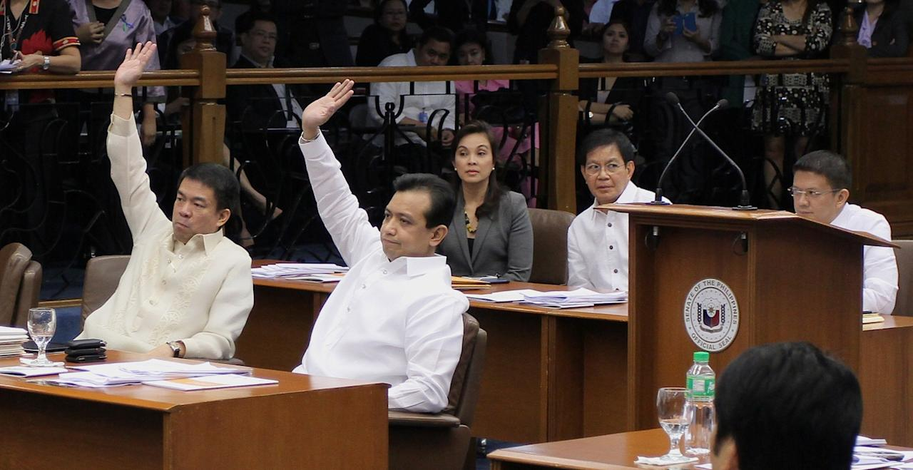 The vote for Enrile's motion. Seen during a session at the Senate in Pasay City, south of Manila, on 21 January 2013. (Joseph Vidal/PRIB/NPPA Images)for