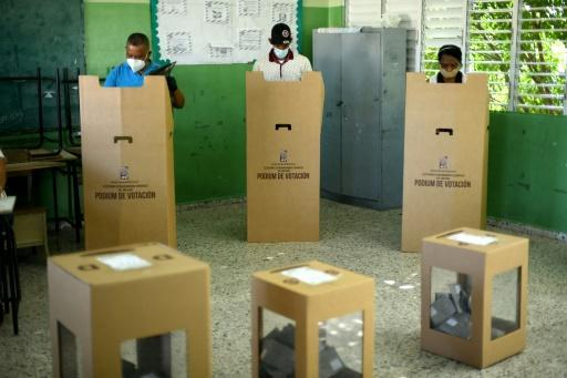 People vote at a polling station during presidential and legislative elections in Santo Domingo, on July 5, 2020