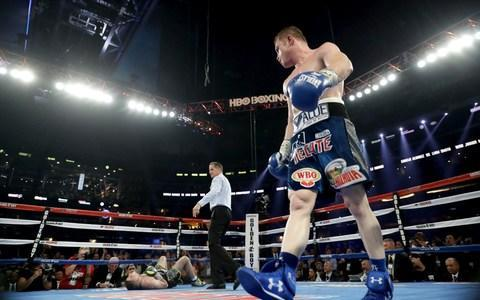 <span>Canelo Alvarez, right, looks toward Liam Smith after knocking him down in 2016</span> <span>Credit: Getty Images </span>