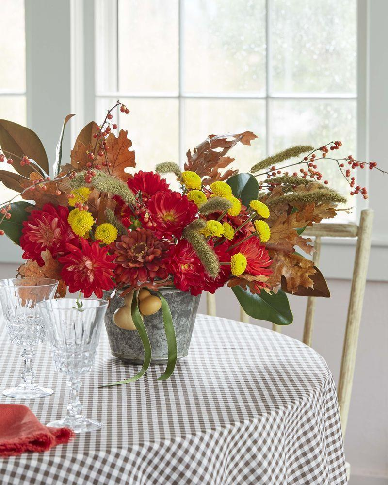 """<p>Go for bold red and yellow blooms instead of the usual muted fall tones. In a vintage pudding tin or other favorite vessel, add flowers first, then mix in fall leaves, berries, magnolia leaves. Pro tip: Start with more stiff/branchy pieces to make a strong base, then move to softer, delicate materials. Finish it off with a ribbon tied with dried gourds.</p><p><a class=""""link rapid-noclick-resp"""" href=""""https://go.redirectingat.com/?id=74968X1525072&xs=1&url=https%3A%2F%2Fwww.etsy.com%2Fsearch%2Fvintage%3Fq%3Dpudding%2Btin%26vintage_rewrite%3Dvintage%2Bpudding%2Btin%26original_query%3D2%26orig_facet%3D&sref=https%3A%2F%2Fwww.countryliving.com%2Fentertaining%2Fg1371%2Fthanksgiving-decorations%2F&xcust=%5Butm_source%7C%5Butm_campaign%7C%5Butm_medium%7C%5Bgclid%7C%5Bmsclkid%7C%5Bfbclid%7C%5Brefdomain%7Cwww.google.com%5Bcontent_id%7Ce9e505cc-d2c0-4684-815f-8098ca389d87%5Bcontent_product_id%7C%5Bproduct_retailer_id%7C"""" rel=""""nofollow noopener"""" target=""""_blank"""" data-ylk=""""slk:SHOP VINTAGE PUDDING TINS"""">SHOP VINTAGE PUDDING TINS</a></p>"""