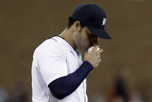 Detroit Tigers pitcher Anibal Sanchez kisses the ball after striking out Atlanta Braves' Juan Francisco in the eighth inning of a baseball game in Detroit, Friday, April 26, 2013. (AP Photo/Paul Sancya)