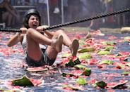 <p>A woman takes part in the 55th annual watermelon festival in LA. (Rex features) </p>