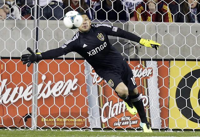 Real Salt Lake goalkeeper Nick Rimando dives as Portland Timbers Will Johnson scores on a free kick in the first half during the first leg of the of the MLS Western Conference final, Sunday, Nov. 10, 2013, in Sandy, Utah. (AP Photo/Rick Bowmer)