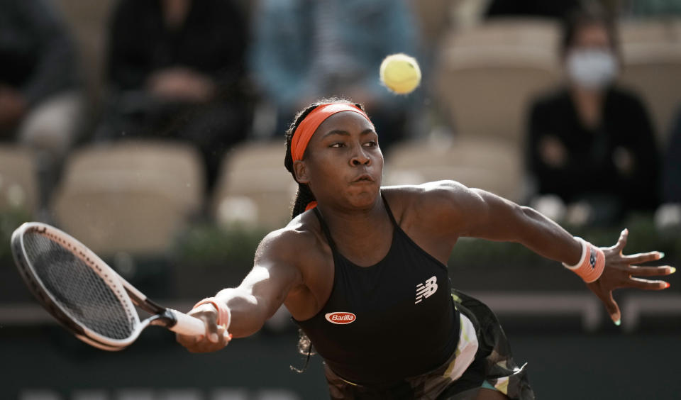 United States's Coco Gauff plays a return to United States's Jennifer Brady during their third round match on day 7, of the French Open tennis tournament at Roland Garros in Paris, France, Saturday, June 5, 2021. (AP Photo/Thibault Camus)