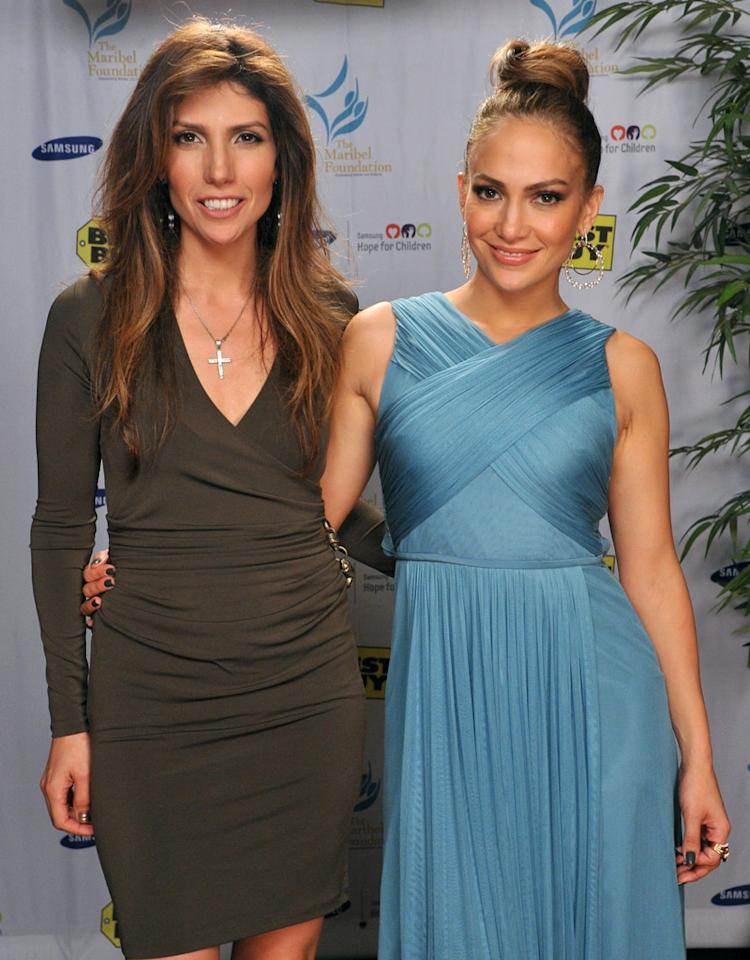 LOS ANGELES, CA - OCTOBER 25:  Jennifer Lopez (R) and Lynda Lopez team with Samsung and Best Buy to support the Maribel Foundation at the Best Buy in West LA on October 25, 2011 in Los Angeles, California.  (Photo by Lester Cohen/WireImage)