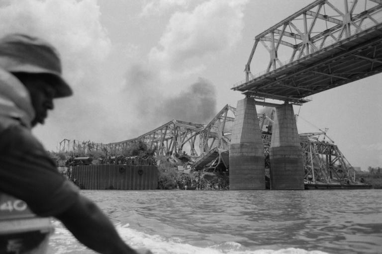 The Onitsha bridge, one of the most important communication pathways of West Africa, is destroyed by the Biafran forces (AFP Photo/Colin HAYNES)