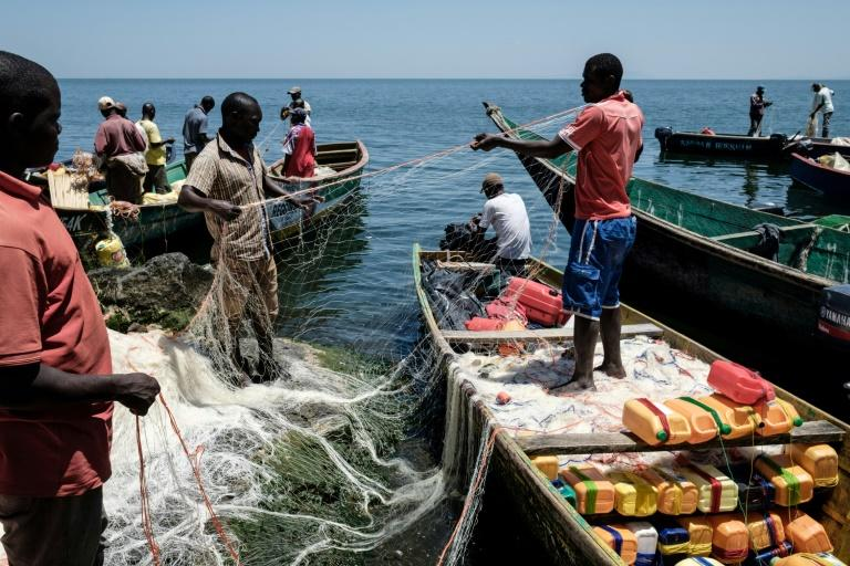 Fishermen preparing their nets on Migingo island whose surrounding waters abound with Nile Perch