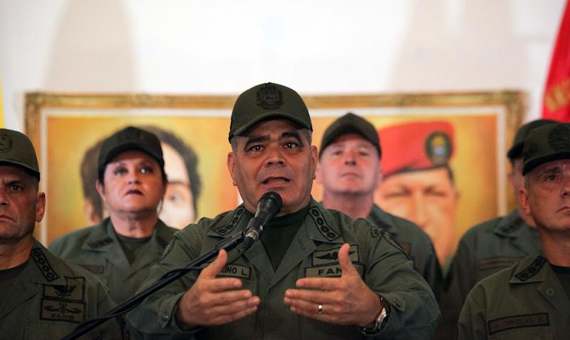 Venezuela's defence minister, General Vladimir Padrino reads out a statement from the armed forces declaring 'absolute loyalty' to President Nicolas Maduro