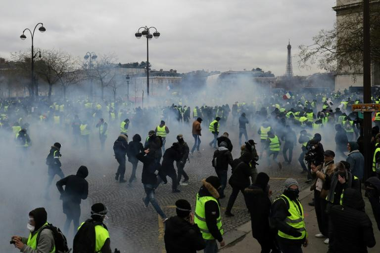 "Police fired tear gas and water cannon to disperse advancing ""yellow vest"" protesters at the Arc de Triomphe in Paris on Saturday"