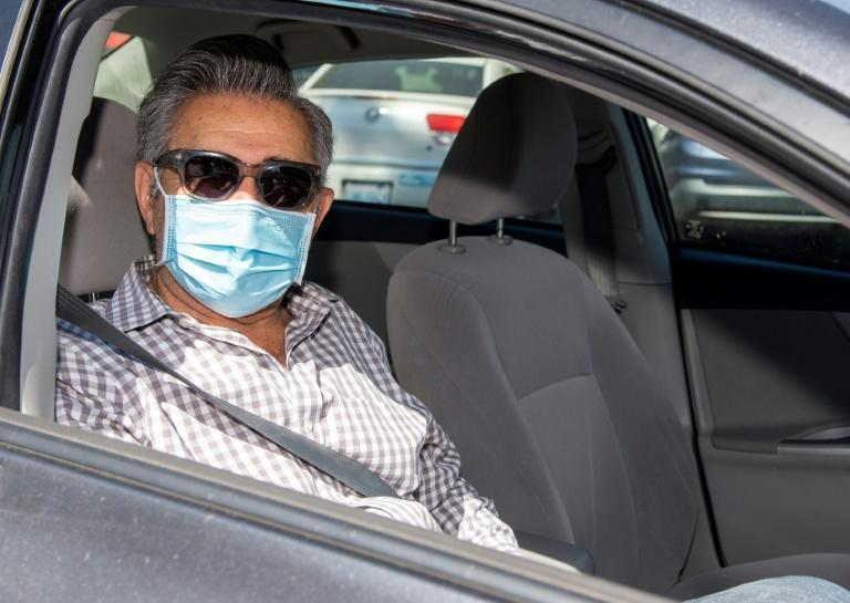 """Actor Eugene Levy -- a Golden Globe nominee for his work on hit TV comedy """"Schitt's Creek,"""" seen here at a pre-gala drive-through """"gifting suite"""" -- says the awards shows must go on"""