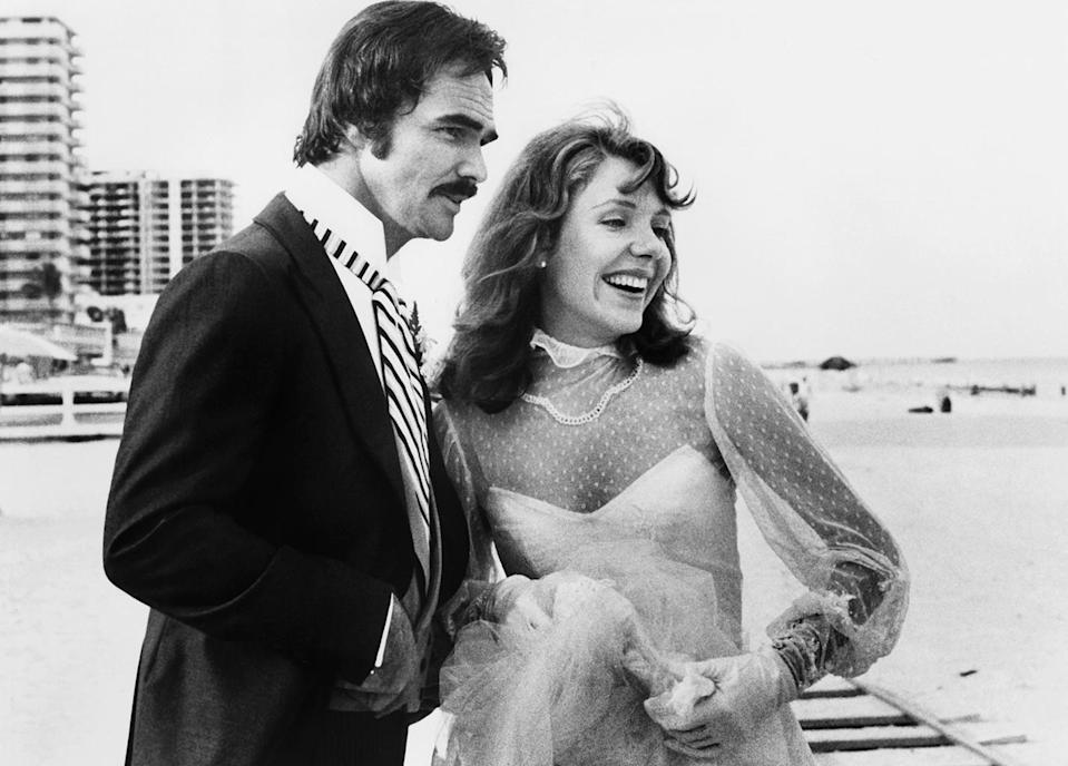 <p>Reynolds found himself playing a former football player again as Billy Clyde Puckett in <em>Semi-Tough</em>. He's seen here with actress Jill Clayburgh in the 1977 romantic comedy. (Photo: United Artists/courtesy Everett Collection) </p>
