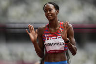 Dalilah Muhammad, of United States, reacts after winning a heat in the women's 400-meter hurdles at the 2020 Summer Olympics, Saturday, July 31, 2021, in Tokyo. (AP Photo/Petr David Josek)