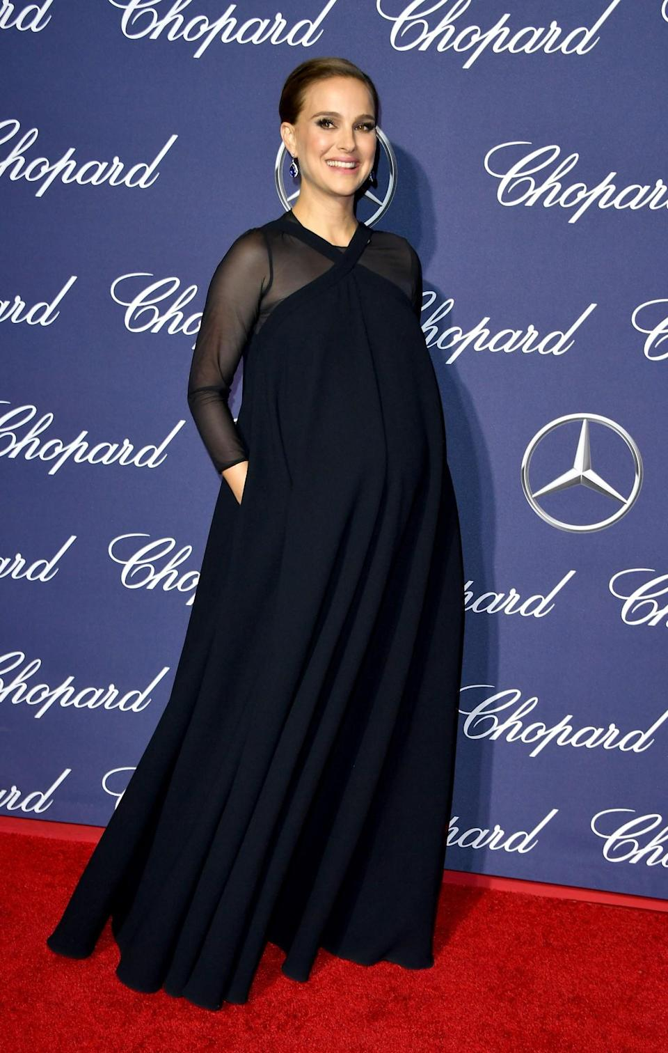 <p>Wearing a dress from the Dior SS17 collection (reworked to include sheer sleeves and accommodate the star's blossoming baby bump), the actress looked both chic and comfortable in this midnight blue designer piece. [Photo: Getty] </p>