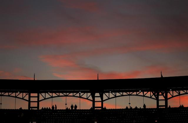 Fans arrive to Busch Stadium for the start of Game 5 of baseball's World Series between the Boston Red Sox and the St. Louis Cardinals Monday, Oct. 28, 2013, in St. Louis. (AP Photo/Charlie Riedel)