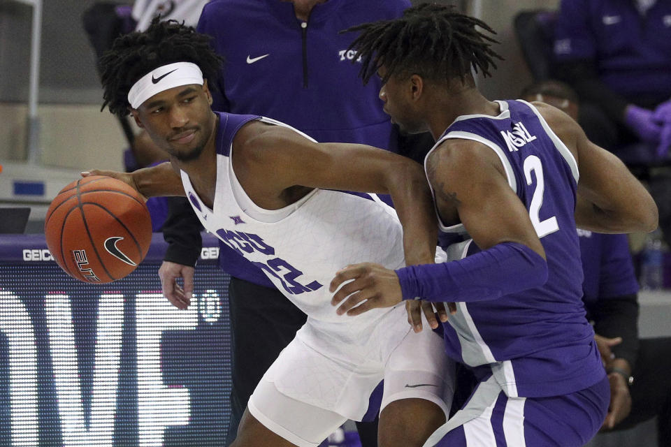 TCU guard RJ Nembhard (22) looks for an opening against Kansas State guard Selton Miguel (2) during the second half of an NCAA college basketball game Saturday, Feb. 20, 2021, in Fort Worth, Texas. (AP Photo/Richard W. Rodriguez)