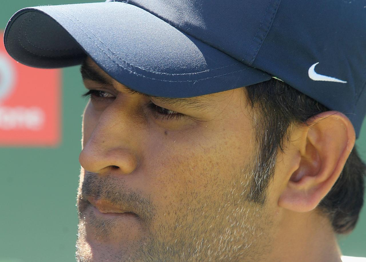 PERTH, AUSTRALIA - JANUARY 15:  MS Dhoni of India looks on during the after match presentations after day three of the Third Test match between Australia and India at WACA on January 15, 2012 in Perth, Australia.  (Photo by Hamish Blair/Getty Images)