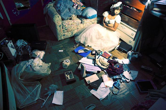 """<p><strong>The First Ten Years</strong></p> <p>I took this on the 10th anniversary of my mother's death. I was playing dress-up in my mother's wedding dress, and I had this drawer of her personal belongings; ID, address book, rings. I decided to deal with them, so I took everything in the drawer, threw it to the ground and started to go through it. I captured the moment and added it to the series. </p> <span class=""""copyright"""">Photographs: Courtesy of Kia LaBeija.</span>"""
