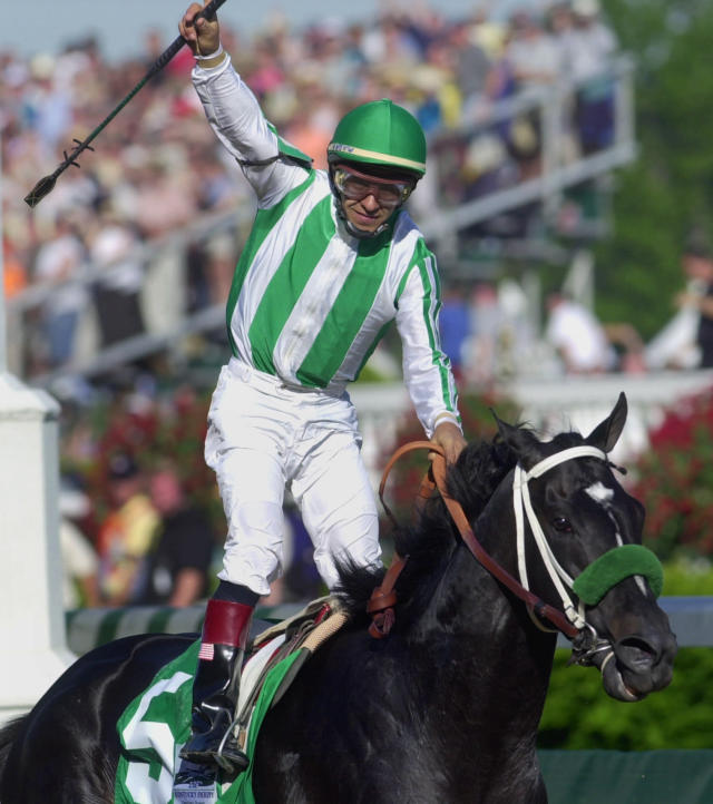 FILE - In this May 4, 2002, file photo, jockey Victor Espinoza celebrates after riding War Emblem to victory in the 128th Kentucky Derby horse race at Churchill Downs in Louisville, Ky. War Emblem, the 2002 Kentucky Derby and Preakness winner, died Wednesday, March 11, 2020, at age 21. (AP Photo/Ed Reinke, File)