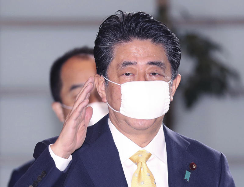 <p>Japan's Prime Minister Shinzo Abe wearing a face mask (abenomask) arrives at Prime Minister's office in Tokyo on May 22, 2020. ( The Yomiuri Shimbun via AP Images )</p>