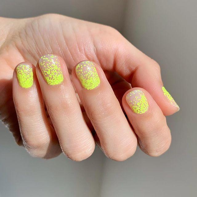 """<p>The neon yellow glitter is one of our fave ombre manicure looks. </p><p><a href=""""https://www.instagram.com/p/BvVCjgKAszk/"""" rel=""""nofollow noopener"""" target=""""_blank"""" data-ylk=""""slk:See the original post on Instagram"""" class=""""link rapid-noclick-resp"""">See the original post on Instagram</a></p>"""