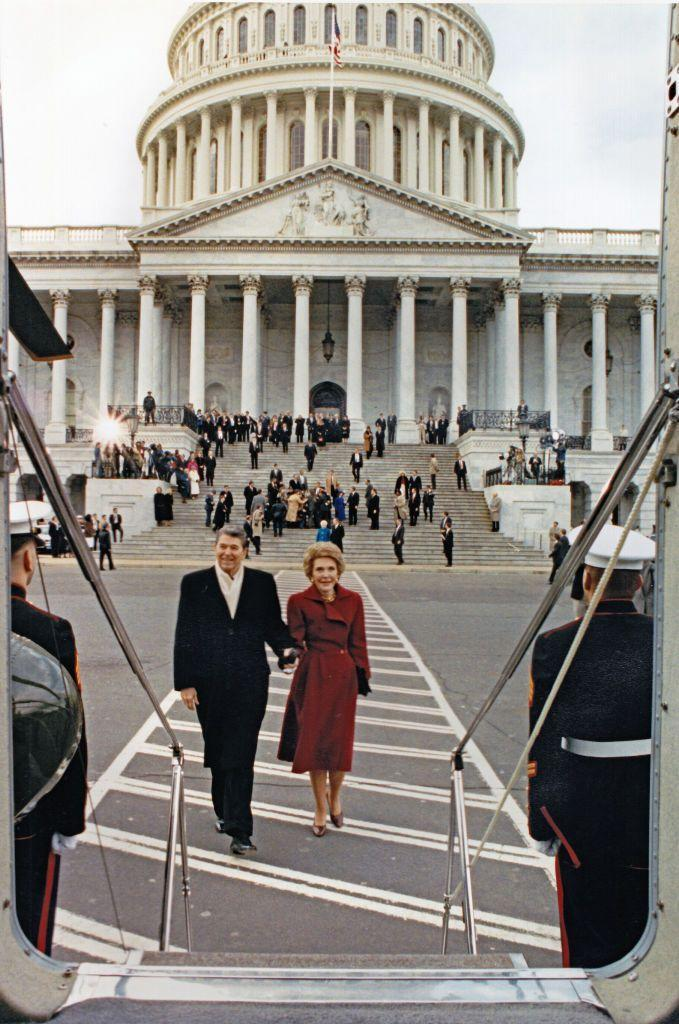<p>The Reagans left the U.S. Capitol after new President George H. W. Bush's inaugural ceremony. The couple is shown here boarding Marine helicopter Nighthawk 1. </p>