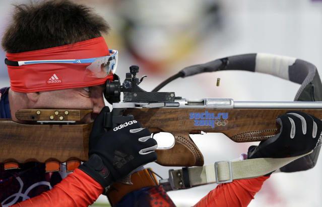 Russia's Yevgeny Garanichev shoots during the men's biathlon 20k individual race, at the 2014 Winter Olympics, Thursday, Feb. 13, 2014, in Krasnaya Polyana, Russia. (AP Photo/Lee Jin-man)