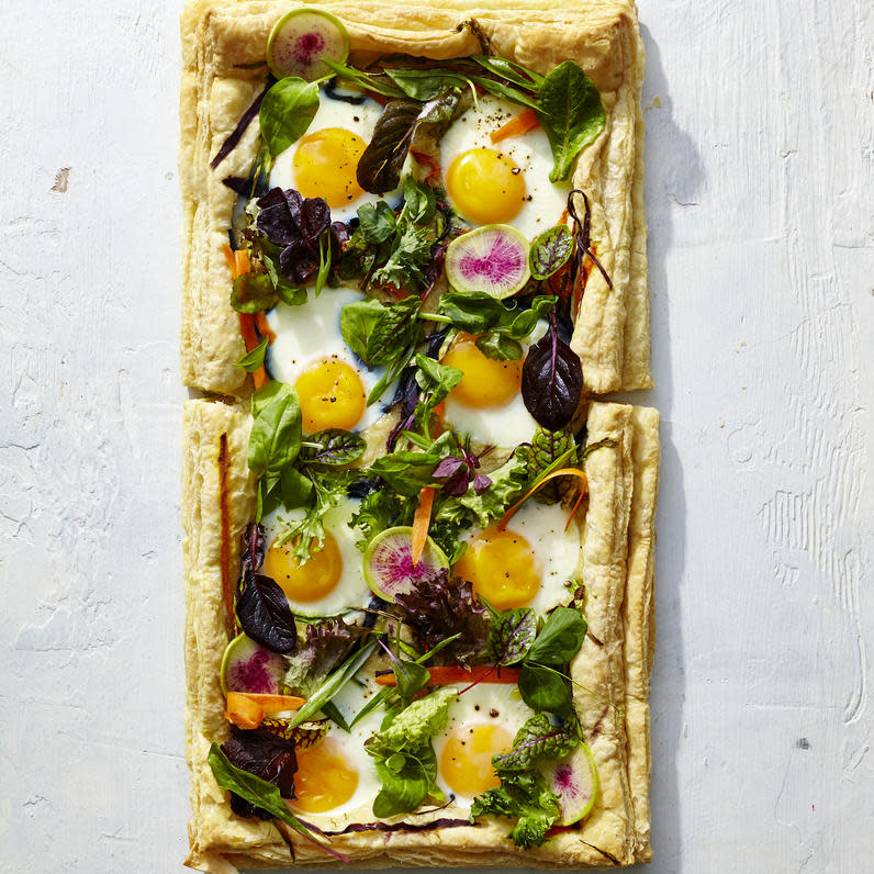 """Thanks to ever-handy, store-bought puff pastry, this stunning savory tart is shockingly easy to make. The flakey puff pastry crust cradles 8 over easy eggs, surrounded with vibrant spring vegetables.  <a rel=""""nofollow"""" href=""""http://www.myrecipes.com/recipe/eggs-in-a-garden"""">Eggs in a Garden Breakfast Tart </a>"""