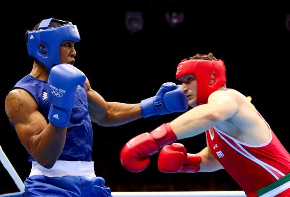 LONDON, ENGLAND - AUGUST 12:  Anthony Joshua (L) of Great Britain exchanges punches with Roberto Cammarelle (R) of Italy during the Men's Super Heavy ( 91kg) Boxing final bout on Day 16 of the London 2012 Olympic Games at ExCeL on August 12, 2012 in London, England.  (Photo by Scott Heavey/Getty Images)