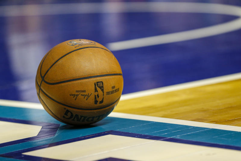 A basketball rests at the baseline during a timeout in an NBA basketball game between the Charlotte Hornets and the Milwaukee Bucks in Charlotte, N.C., Sunday, March 1, 2020. Milwaukee won 93-85. (AP Photo/Nell Redmond)
