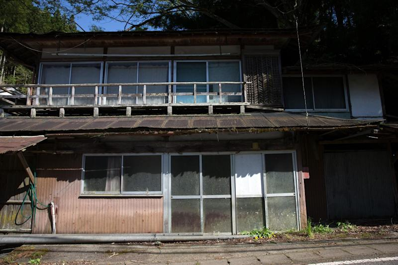 An abandoned house is pictured in a small village on April 22, 2016 in Miyoshi, Japan: Getty Images