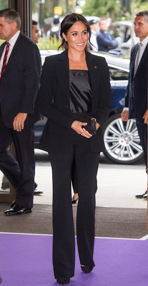 <p>For the WellChild Awards on September 4, the Duchess of Sussex suited up in an Altuzarra co-ord. She accessorised the slick look with a Stella McCartney clutch and a silky blouse courtesy of Swedish label, Deitas. <em>[Photo: Getty]</em> </p>
