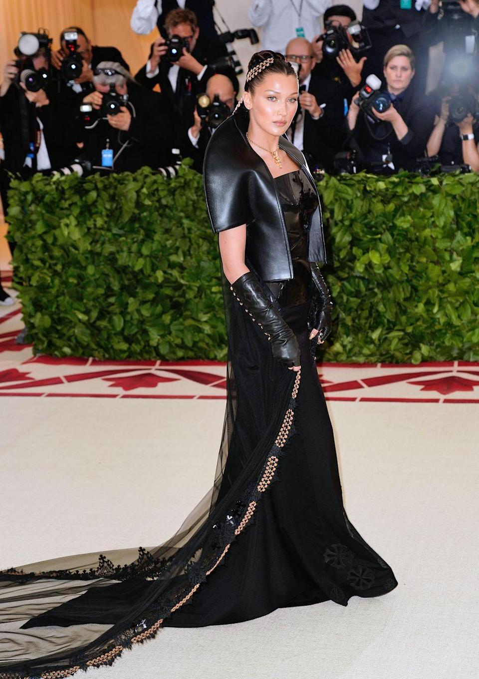 <p>The A-lister arrived at the 2018 Met Gala in a black gown with a sheer train and gold cross necklace created custom for her by Chrome Hearts, with whom she has a collection.<br></p>
