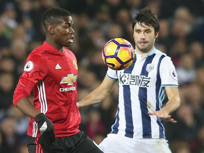 Paul Pogba and Claudio Yacob battle for the ball: Getty