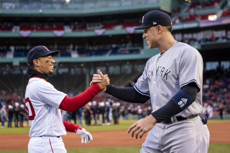 BOSTON, MA - APRIL 11: Mookie Betts #50 of the Boston Red Sox high fives Aaron Judge #99 of the New York Yankees before a game on April 11, 2018 at Fenway Park in Boston, Massachusetts. (Photo by Billie Weiss/Boston Red Sox/Getty Images)