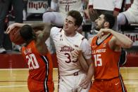 Illinois's Da'Monte Williams (20) and Giorgi Bezhanishvili (15) go after a loose ball with Wisconsin's Nate Reuvers during the second half of an NCAA college basketball game Saturday, Feb. 27, 2021, in Madison, Wis. (AP Photo/Morry Gash)