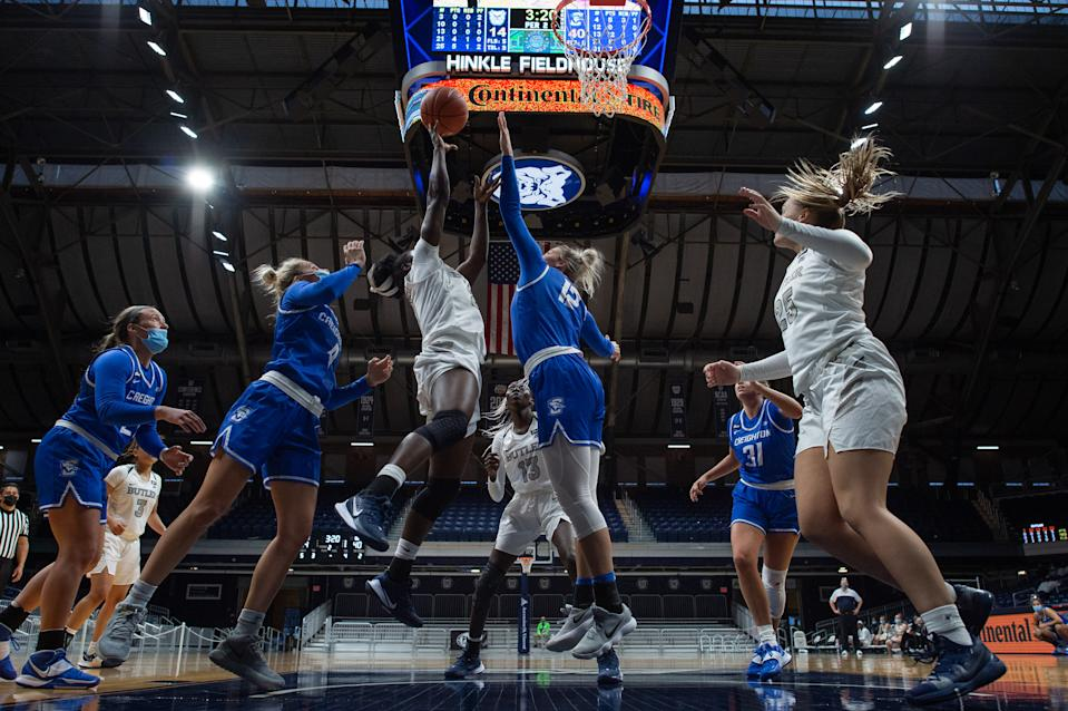 INDIANAPOLIS, IN - DECEMBER 06: Butler Bulldogs guard Upe Atosu (21) shoots in the lane over Creighton Bluejays forward Gracey Griglione (12) during the women's college basketball game between the Butler Bulldogs and Creighton Bluejays on December 6, 2020, at Hinkle Fieldhouse in Indianapolis, IN. (Photo by Zach Bolinger/Icon Sportswire via Getty Images)