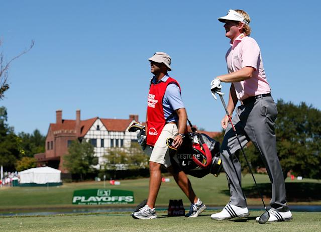 ATLANTA, GA - SEPTEMBER 23: Brandt Snedeker waits on the seventh tee alongside his caddie Scott Vail during the final round of the TOUR Championship by Coca-Cola at East Lake Golf Club on September 23, 2012 in Atlanta, Georgia. (Photo by Kevin C. Cox/Getty Images)