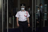 Chris Tang, commissioner of the Hong Kong Police Force, arrives for a press conference in Hong Kong, Wednesday, May 12, 2021. A top Hong Kong national security officer was reportedly caught up in a raid on an unlicensed massage business, and will face a police force investigation into the alleged misconduct. Hong Kong's Director of National Security Frederic Choi has since been put on leave after the incident, according to Tang. (AP Photo/Kin Cheung)