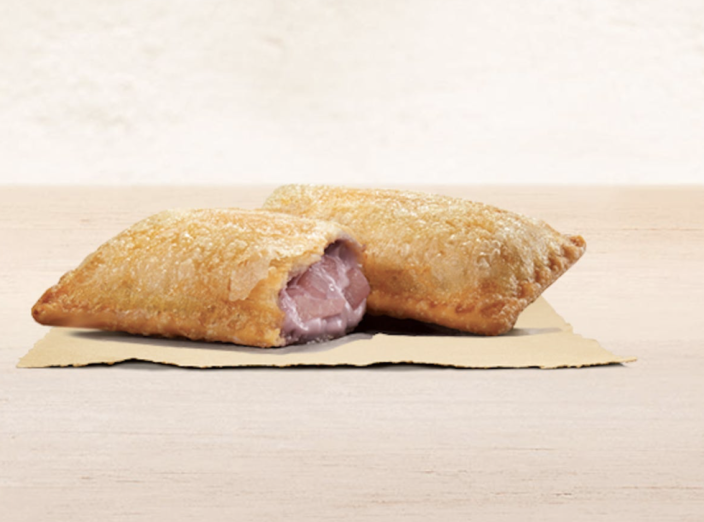 <p>Inside the crispy pie crust is a sweet filling made of taro chunks–a purple root vegetable with a sweet and nutty taste. </p>