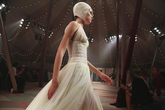 A model wears a creation for the Dior Spring/Summer 2019 Haute Couture fashion collection presented in Dubai, United Arab Emirates, Monday, March 18, 2019. (AP Photo/Jon Gambrell)