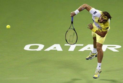 David Ferrer returns the ball to Dustin Brown during the 2013 ATP Qatar Open in Doha on January 1, 2013