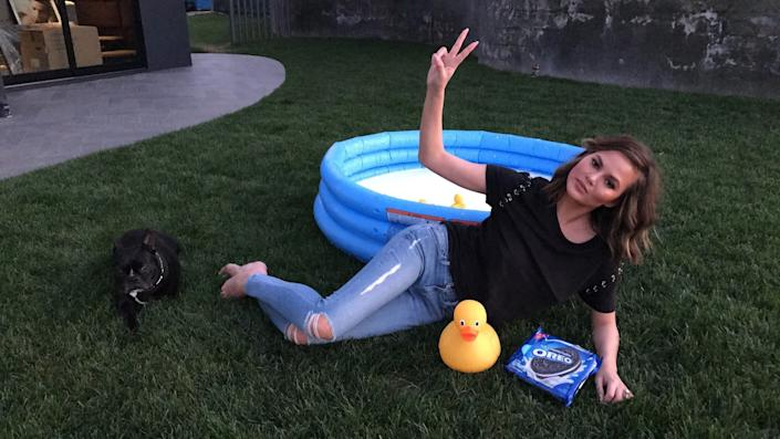 Chrissy Teigen strikes a pose after doing the OREO Dunk Challenge.