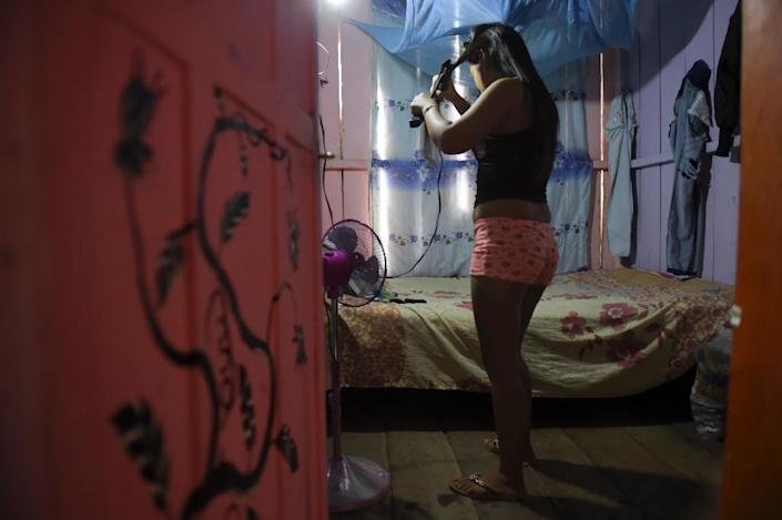 Sex workers in Calamar are given little help but one charity, Doctors of the World, does provide them with medical check-ups, free condoms and food (AFP Photo/Raul ARBOLEDA)