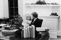 <p>President Carter took a break in the Oval Office to chat with his daughter, Amy. </p>