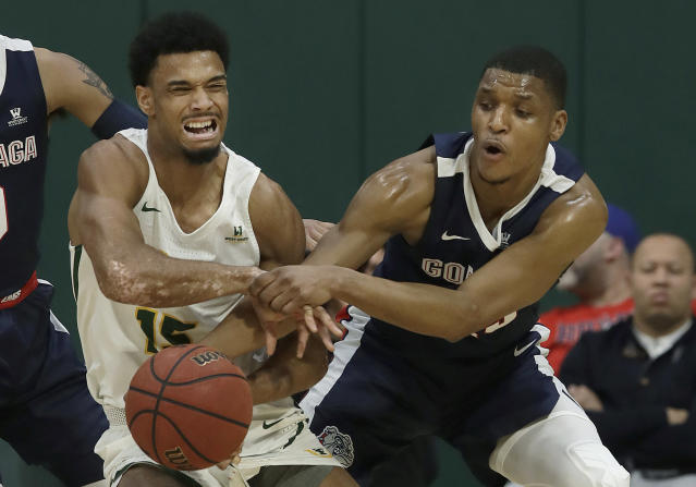 San Francisco forward Nate Renfro, left, wrestles for the ball with Gonzaga guard Zach Norvell Jr. during the first half of an NCAA college basketball game in San Francisco, Saturday, Jan. 12, 2019. (AP Photo/Jeff Chiu)