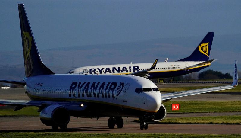 FILE PHOTO: A Ryanair plane prepares to land at Manchester Airport in Manchester Britain.