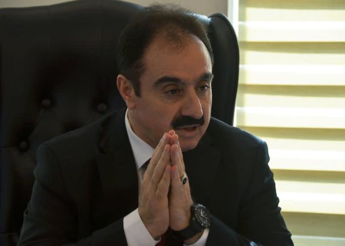 Mohamed Afif, the lawyer of former royal court chief Bassem Awadallah, speaks during an interview with Reuters in his office in Amman
