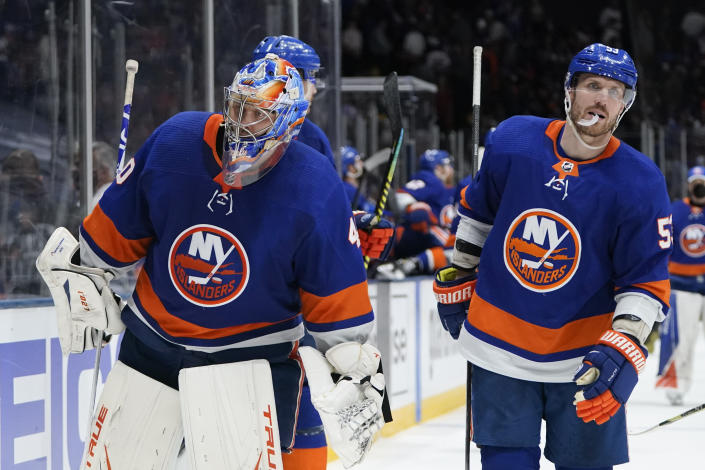 New York Islanders goaltender Semyon Varlamov (40) and Casey Cizikas (53) leave the ice after Game 3 during an NHL hockey second-round playoff series against the Boston Bruins Thursday, June 3, 2021, in Uniondale, N.Y. The Bruins won 2-1. (AP Photo/Frank Franklin II)