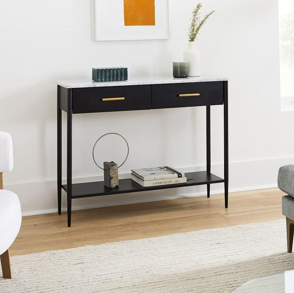 <p>This <span>West Elm Metalwork Console With Marble Top</span> ($699) is an elegant piece.</p>
